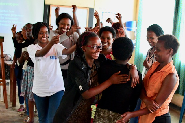 Students at the Kiziba refugee camp rejoice after winning a debate on gender roles